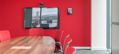 Acoustic wall with red fabric finish