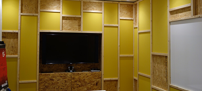 Yellow acoustic wall panels in meeting room