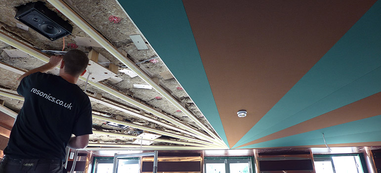 Installation process of acoustic ceiling in restaurant.