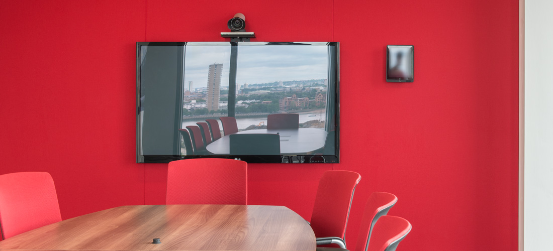 Red acoustic wall in conference room