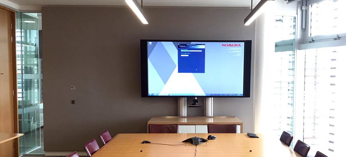 boardroom with table, chairs and TV screen on the end wall.