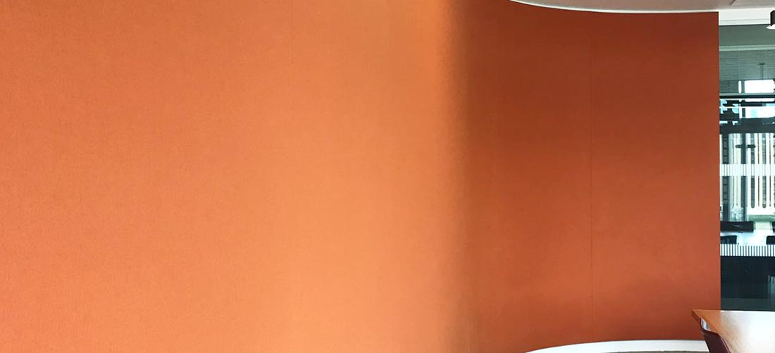 curved all with orange fabric surface
