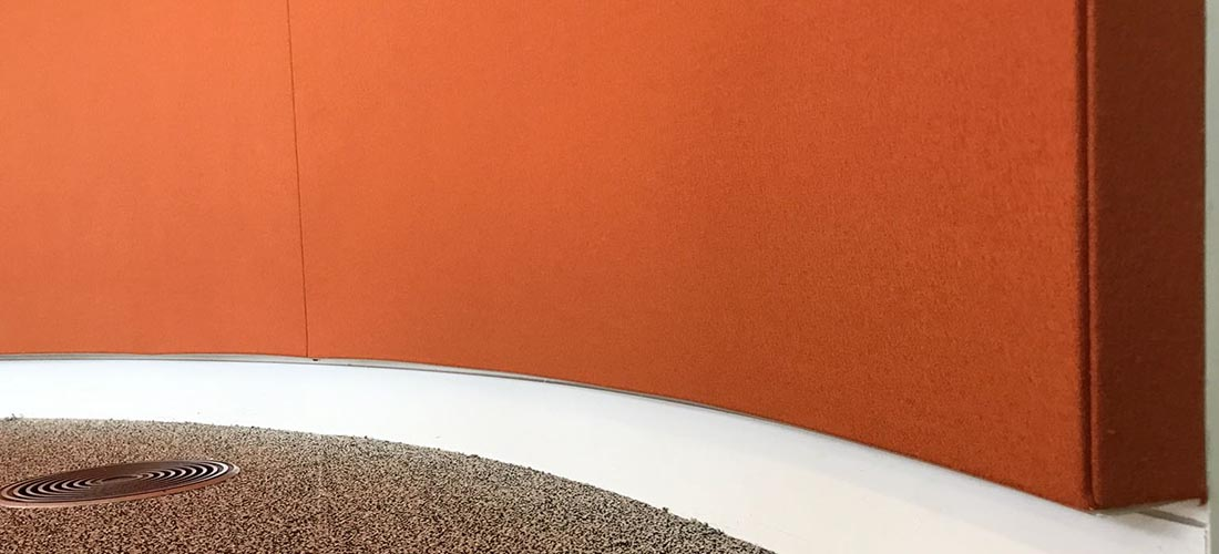 Bottom of curved fabric wall in orange