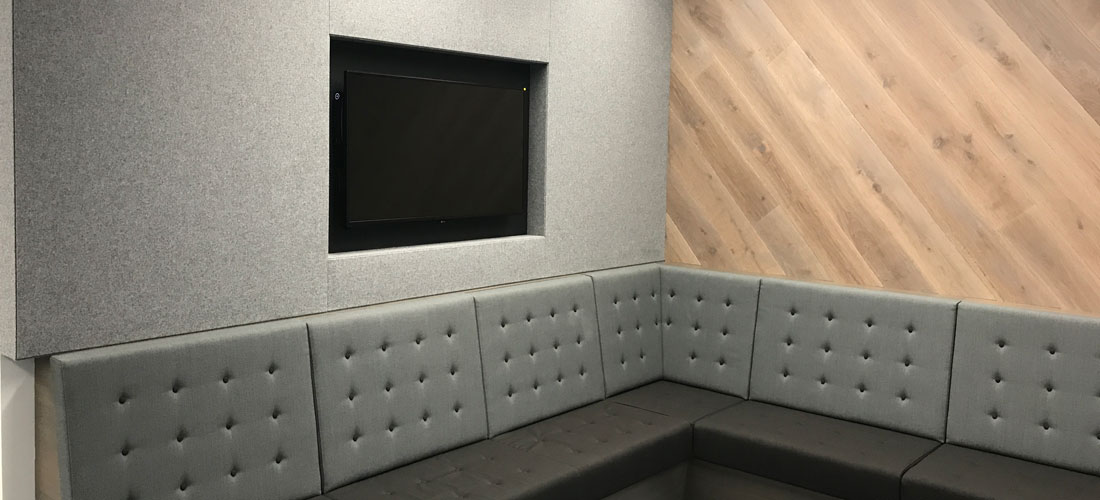 Grey acoustic wall in break out area
