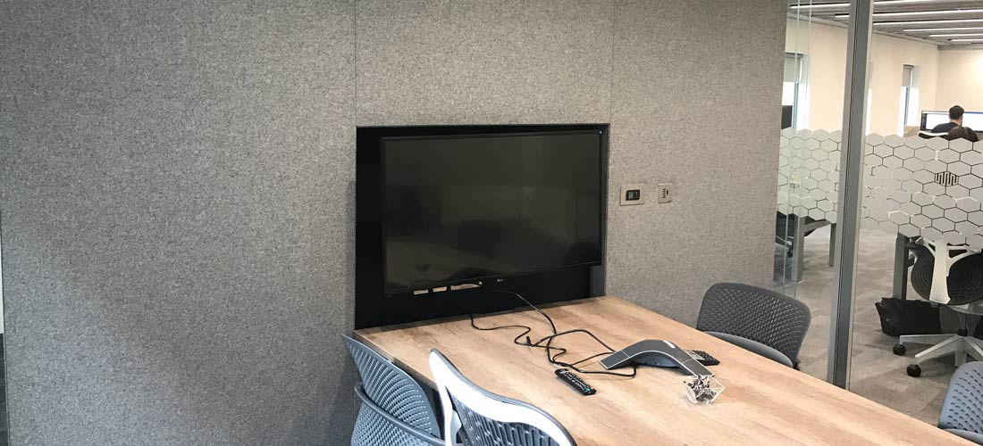 Grey acoustic wall in conference room